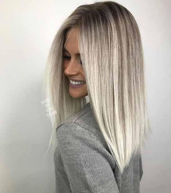 Ombre saç modelleri - Resimde ombre boyama tekniği uygulanmış, kadına ait uzun saç görseli var.
