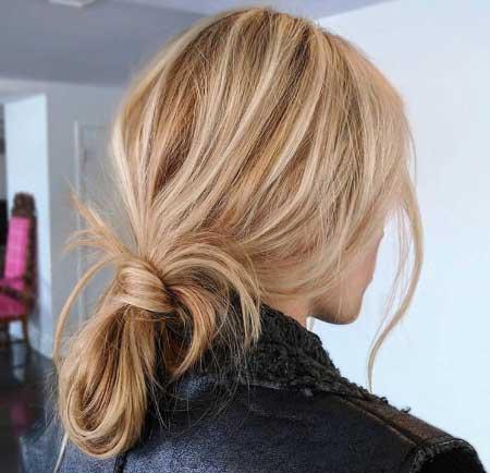 Dağınık Topuz Saç Modelleri - Resimde güzel bir kadına ait at kuyruğu topuz saç stili var.