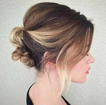 Düğün Saç Modelleri 2018 yazısı için kullanılan resimde topuzlu kısa kesim saç stiline sahip güzel bir gelin var.