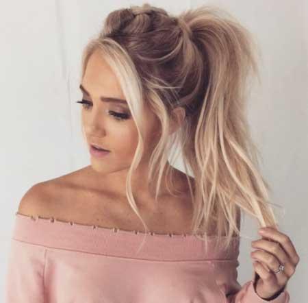 Uzun ince telli saçlar için saç kesim modelleri bayan - Resimde uzun, at kuyruklu ve hacimli ince telli saça sahip güzel bir kadın var.